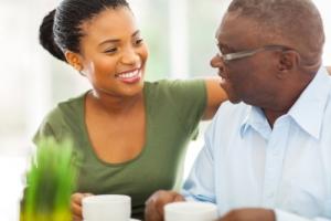 elderly man enjoying coffee with his caregiver