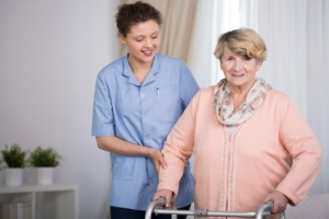 senior women and supporting nurse at home