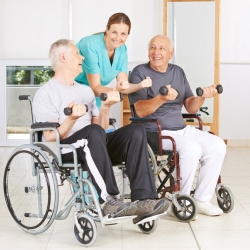 physiotherapist with two elderly man in wheelchairs